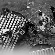 The point of no return: Migrants en route to the United States use a bridge, a raft, or wade across the Rio Suchiate from El Carmen, San Marcos Department, Guatemala to Chiapas, Mexico. Many migrants cross from Mexico to the United States, though illegal immigration from Mexico and Guatemala is down in numbers, and the death rate is higher due to longer walks through the Arizona desert.