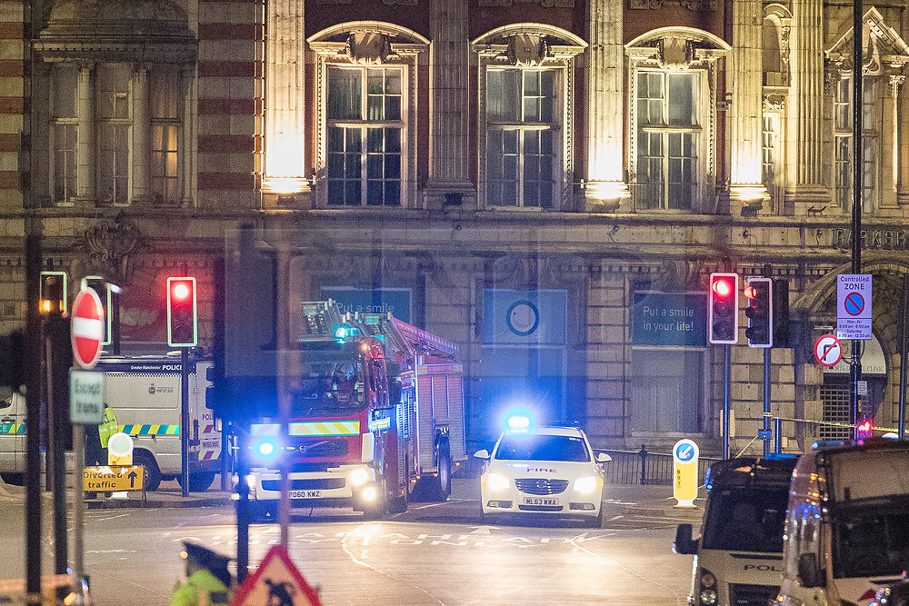 © Licensed to London News Pictures. Manchester, UK . As Manchester prepares to mark a year since the Manchester Arena terror attack FILE PICTURED TIMED AT 00:28 on 23rd May 2017 of a second fire engine arriving along Corporation Street to the Manchester Arena . The Kerslake Report in to the terrorist bombing of an Ariana Grande concert at the Manchester Arena on 22nd May 2017 highlighted failings in communication and culture at Greater Manchester Fire and Rescue which lead to a two hour delay in Greater Manchester Fire and Rescue's response to the bombing . Photo credit: Joel Goodman/LNP
