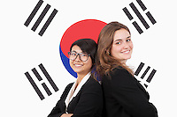 Portrait of young multiethnic businesswomen smiling over Korean flag