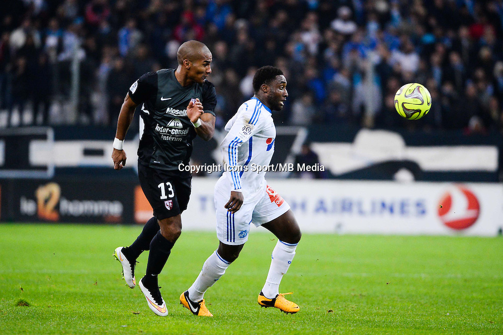 Florent MALOUDA / Brice DJA DJEDJE - 07.12.2014 - Marseille / Metz - 17eme journee de Ligue 1 -<br />Photo : Gaston Petrelli / Icon Sport