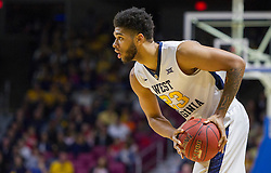 Nov 16, 2015; Charleston, WV, USA; West Virginia Mountaineers forward Esa Ahmad looks to pass the ball during the first half against the James Madison Dukes at the Charleston Civic Center. Mandatory Credit: Ben Queen-USA TODAY Sports
