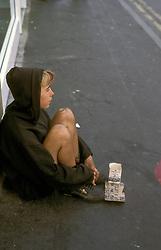 Homeless woman begging in street Huddersfield UK