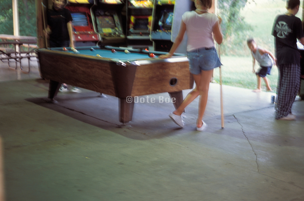 Young people playing pool and video games