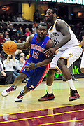 Feb. 9, 2011; Cleveland, OH, USA; Detroit Pistons point guard Will Bynum (12) drives past Cleveland Cavaliers power forward J.J. Hickson (21) during the fourth quarter at Quicken Loans Arena. The Pistons beat the Cavaliers 103-94 for Cleveland's 26th loss in a row. Mandatory Credit: Jason Miller-US PRESSWIRE