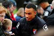 AFC Bournemouth midfielder Junior Stanislas signing autographs outside the Vitality Stadium before The FA Cup match between Bournemouth and Everton at the Goldsands Stadium, Bournemouth, England on 20 February 2016. Photo by Graham Hunt.