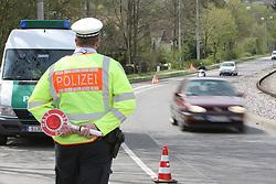 THEMENBILD - In Deutschland ist die Zuständigkeit für die Geschwindigkeitsüberwachung in den Bundesländern teilweise unterschiedlich geregelt. In den meisten Bundesländern sind die Polizei und regionale Ordnungsbehörden mit der Verkehrsüberwachung beauftragt. Während die Ordnungsämter der Kommunen innerhalb der geschlossenen Ortschaften zuständig sind, überwachen die Polizei und teilweise auch die Kreisverwaltungen den außerörtlichen Bereich auf den Kreis-, Landes- und Bundesstraßen sowie den Autobahnen. Hier im Bild Polizist mit Haltekehle an einer Kontrollstelle in Stuttgart wartet auf Temposuender. Aufgenommen am 15. April 2015 in Stuttgart // In Germany, the responsibility for the speed control in the provinces is partly regulated differently. In most states, the police and local planning authorities are in charge of traffic control. While the regulatory agencies of the municipalities are responsible within the built-up areas, the police and sometimes the county governments monitor the non-urban area in the district, state and federal roads and highways. In this picture policeman at a checkpoint in Stuttgart waiting for speeders. Photo was taken on April 15, 2015 Stuttgart. EXPA Pictures © 2015, PhotoCredit: EXPA/ Eibner-Pressefoto/ Fudisch<br /> <br /> *****ATTENTION - OUT of GER*****