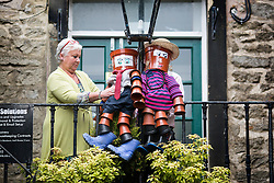 © Licensed to London News Pictures. 26/06/2015. Settler, UK. Settle flower Festival. The market town of Settle in the Yorkshire Dales is set to go flower pot mad over the weekend with the second Flower Pot Festival taking place. Locals in the town use the flower pots to make men, snakes, dogs, spiders & even a darlek. Photo credit : Andrew McCaren/LNP