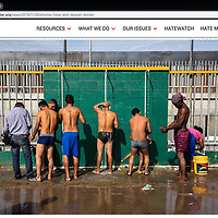 Asylum seekers who had traveled from Central America shower in an open field. The migrants were looking at months before their number would be called. Photographed for Southern Poverty Law Center.