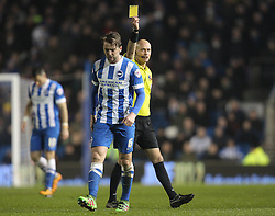 Dale Stephens of Brighton and Hove Albion is shown a yellow card by referee, Darren Drysdale - Mandatory byline: Paul Terry/JMP - 08/03/2016 - FOOTBALL - Falmer Stadium - Brighton, England - Brighton v Sheffield Wednesday - Sky Bet Championship