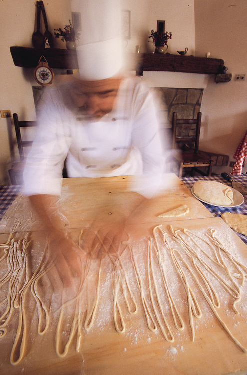 Europe, Italy, Montepulciano, Chef making pasta (blurred motion).