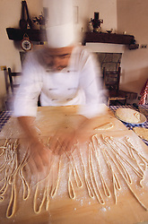 Europe, Italy, Montepulciano, Chef making pasta (blurred motion).
