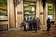 Roma, 13 Febbraio 2014<br /> Manifestazione dei movimenti di lotta per la casa dopo gli arresti di 17  attivisti per  gli scontri con la polizia del 31 ottobre a via del Tritone, durante la manifestazione contro la conferenza  Stato,Regioni,province,comuni sul tema della casa.Le forze dell'ordine in assetto antisomossa a protezione del giornale Il Messaggero del costruttore Caltagirone<br /> Rome , February 13, 2014<br /> Demostration  of the  movements for housing rights, after the arrests,  today  of 17 activists for the  clashes with the police,  the  31 October at Via del Tritone , during the demonstration against the conference between state, regions, provinces, municipalities on the theme of the house.The police in riot gear to protect the newspaper Il Messaggero , owned by the manufacturer Caltagirone