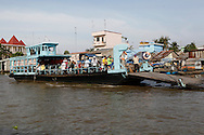 A feryboat along the Mekong River in Vietnam<br /> <br />  photo by Dennis Brack
