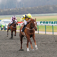 Moment In The Sun and William Carson winning the 2.40 race