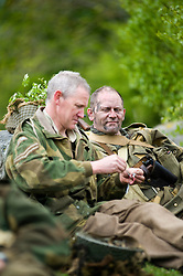 Reenactor from Northern World War Two Association, portraying the 6th Airborne Division 22nd Independent Company stop for a break during a private 24hr excerise, held at Sutton Grange, near Ripon in Yorkshire 15  May 2010 .Images © Paul David Drabble