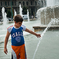 MILAN, ITALY - JULY 02:  Hot Weather in Milan with boys and girls playing in the fountain at Castello Sforzesco, pensioner enjoy watermelo, Ice Cream and relaxing in the shade on July 2, 2010 in Milan, Italy. Italy is experiencing a  week of very high summer temperatures.