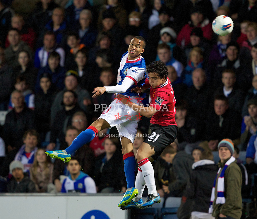BLACKBURN, ENGLAND - Monday, April 2, 2012: Manchester United's Rafael da Silva in action against Blackburn Rovers' Marcus Olsson during the Premiership match at Ewood Park. (Pic by Vegard Grott/Propaganda)