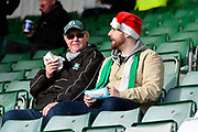 A Plymouth Argyle fan inside Home Park Stadium wearing a Christmas hat before the EFL Sky Bet League 1 match between Plymouth Argyle and Accrington Stanley at Home Park, Plymouth, England on 22 December 2018.