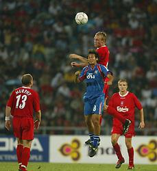 BANGKOK, THAILAND - Thailand. Thursday, July 24, 2003: Liverpool's Sami Hyypia rises above Thailand's Amarin Madlam to win a header during a preseason friendly match at the Rajamangala National Stadium. (Pic by David Rawcliffe/Propaganda)