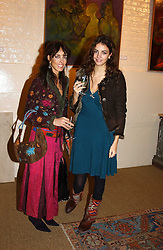 Left to right, MRS TIM HANBURY and her daughter MISS ROSE HANBURY at an exhibition of recent work by artist Lance Tilbury held at the Old Imperial Laundry, Warriner Gardens, Battersea, London on 7th December 2004.<br />