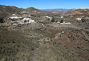 Landscape and small village Rambla Honda, in Sierra Alhamilla mountains, near Nijar, Almeria, Spain