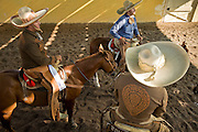 31 AUGUST 2007 -- PHOENIX, AZ: Competitors at the at the Congreso y Campeonato Nacional Charro in Phoenix, AZ, Friday, August 31 wait to enter the arena. The event is the US championship for the Mexican Federacion Mexicana de Charreria. The winners of the US championship go on to compete in the Mexican Charreada championships in Morelia, Michoacan, Mexico in October. Charreadas are Mexican style rodeos that are popular in Mexican communities throughout the US. As the Mexican immigrant community has expanded throughout the US, the sport has expanded with it. Charreadas are now held as far north as Minnesota and along the US - Mexico border.   Photo by Jack Kurtz