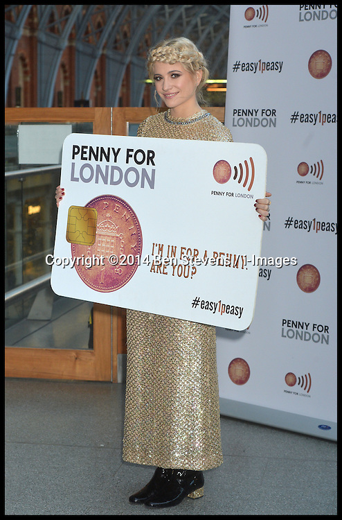 Image &copy;Licensed to i-Images Picture Agency. 16/12/2014. London, United Kingdom. <br /> <br /> Pixie Lott busks at St Pancras Station, London,  in support for Penny for London charitable revolution.<br /> <br /> Picture by Ben Stevens / i-Images