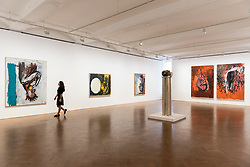 """© Licensed to London News Pictures. 02/10/2018. LONDON, UK. A general view of gallery space. Preview of """"A Focus on the 1980s"""", an exhibition of works by Georg Baselitz at Galerie Thaddaeus Ropac in Mayfair.  The show features seminal paintings, previously unseen works, drawings and early sculptures by the artist during his breakthrough decade and runs 3 October to 21 November 2018.  Photo credit: Stephen Chung/LNP"""