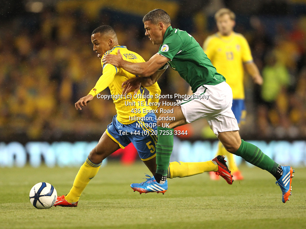 06/09/2013 FIFA 2014 World Cup Qualifying - Group C . Rep of Ireland v Sweden<br /> Martin Olsson and Jon Walters<br /> Photo: John Halas