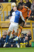 Blackburn Rovers striker Chris Brown and Wolverhampton Wanderers defender Dominic Iorfa battle for a header during the Sky Bet Championship match between Wolverhampton Wanderers and Blackburn Rovers at Molineux, Wolverhampton, England on 9 April 2016. Photo by Alan Franklin.