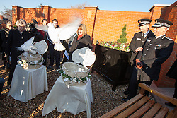 © Licensed to London News Pictures . 13/12/2012 . Hyde, Greater Manchester , UK . L-R June Bone (Fiona Bone's mother) and Sue Hughes (Nicola Hughes' mother) release doves as Chief Superintendent Nick Adderley and Chief Constable Sir Peter Fahy watch . A memorial garden dedicated to PCs Fiona Bone and Nicola Hughes is opened at Hyde Police Station . The two officers were killed when responding to a routine call , earlier this year . Photo credit : Joel Goodman/LNP