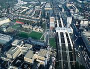 Nederland, Zuid-Holland, Leiden, 01-12-2005; luchtfoto (25% toeslag); omgeving Centraal Station,  stationsgebied met rechts binnenstad Leiden, links het oude Poortgebouw, het oorspronkelijke academische ziekenhuis (gelegen aan het aan het grasveld); het huidige universitaire ziekenhuis is het Leids Universitair Medisch Centrum (LUMC) -linksonder; planologie, stadsontwikkeling, gezondheidszorg, spoorwegen, NS, treinen; zie ook andere (lucht)foto's.foto Siebe Swart