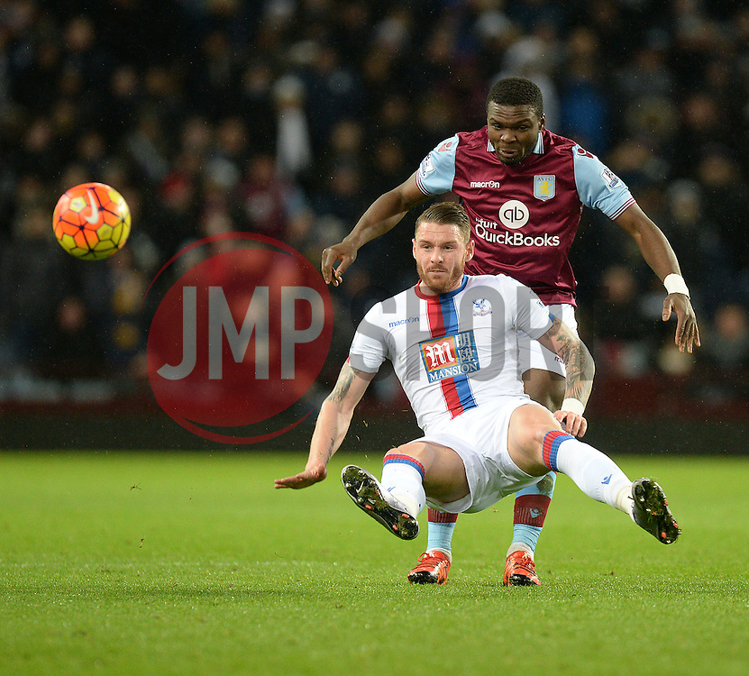Jores Okore of Aston Villa tackles Connor Wickham of Crystal Palace - Mandatory byline: Alex James/JMP - 12/01/2016 - FOOTBALL - Villa Park - Birmingham, England - Aston Villa v Crystal Palace - Barclays Premier League