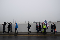 © Licensed to London News Pictures . 20/01/2018. Doncaster, UK. EDL protesters march to the demonstration . Far-right street protest movement , the English Defence League ( EDL ) , hold a demonstration , opposed by anti-fascists , including Unite Against Fascism ( UAF ) in the Hexthorpe area of Doncaster . EDL supporters chanted anti-Roma slogans as they marched through the town . Photo credit: Joel Goodman/LNP