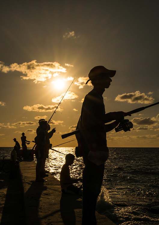 HAVANA, CUBA - CIRCA MAY 2016:  People fishing from the Malecon in Havana, Cuba.