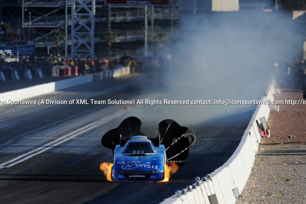2016 April 01 | Friday: Tommy Johnson Jr (3 FC) Don Schumacher Racing (DSR) Dodge Charger NHRA Funny Car shows flames out the bottom during the second round of qualifying for the 17th Annual Densco Spark Plugs NHRA Nationals at The Strip at Las Vegas Motor Speedway in Las Vegas, Nevada.  (Photo by David Allio/Icon Sportswire)