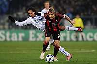 FOOTBALL - CHAMPIONS LEAGUE 2010/2011 - GROUP STAGE - GROUP G - AJ AUXERRE v MILAN AC - 23/11/2010 - MASSIMO AMBROSINI (MILAN) - ROY CONTOUT (AJA) - PHOTO FRANCK FAUGERE / DPPI