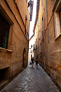A couple walk the narrow streets of Palma de Mallorca, Balearic Islands, Spain