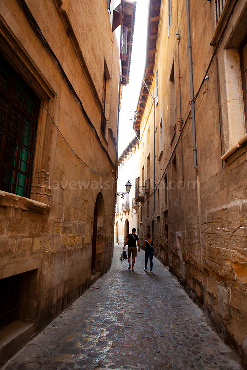 A couple walk the narrow streets of Palma de Mallorca, Balearic Islands, Spain