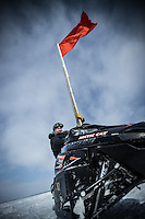 The finish line flag is moved at Tasirlak after the dog sled race is over on Saturday April 11th, 2015.