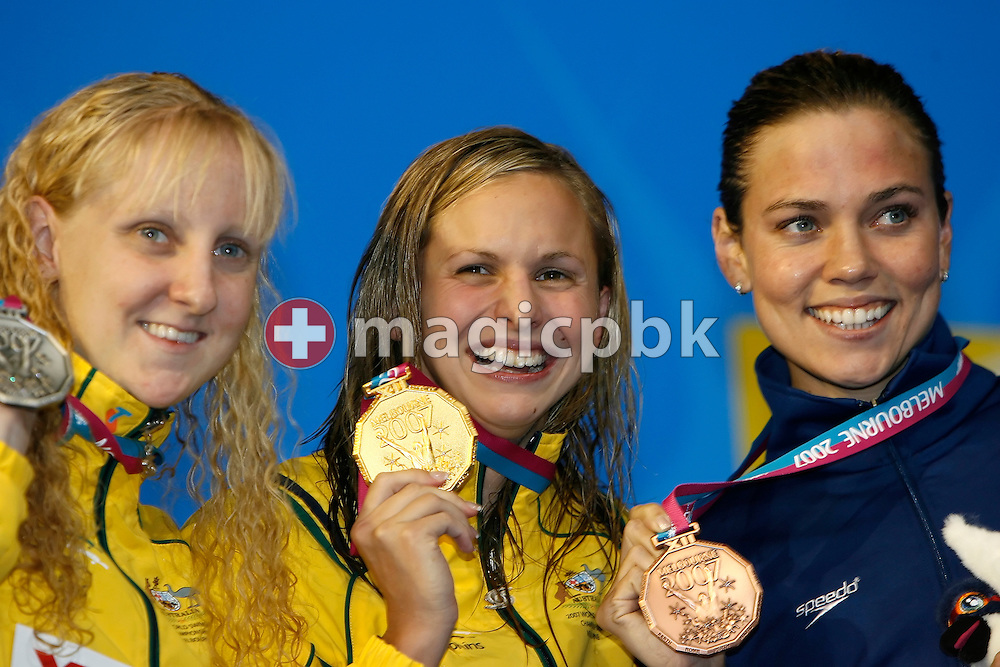 (L-R) Second placed Jessicah Schipper of Australia, winner Lisbeth (Libby) Lenton of Australia and third placed Natalie Coughlin of the USA show their medals during the award ceremony for the women's 100m butterfly final in the Susie O'Neill pool at the FINA Swimming World Championships in Melbourne, Australia, Monday 26 March 2007. (Photo by Patrick B. Kraemer / MAGICPBK)
