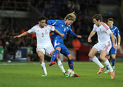 Neil Taylor of Wales (Swansea City) fouls Birkir Bjarnason (Sampdoria) of Iceland  - Photo mandatory by-line: Dougie Allward/JMP - Tel: Mobile: 07966 386802 03/03/2014 -