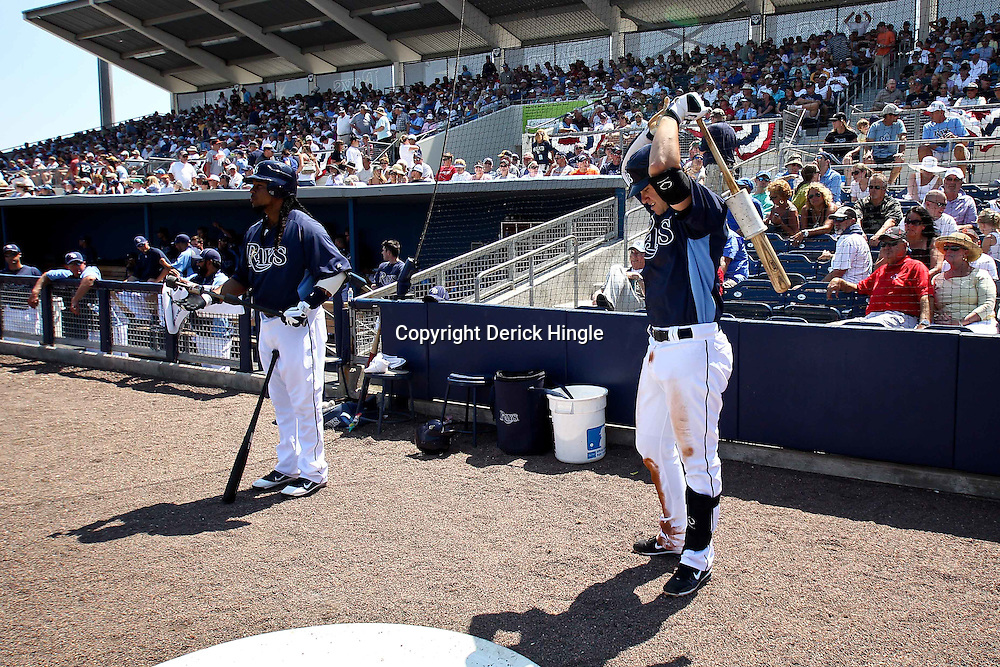 March 20, 2011; Port Charlotte, FL, USA; Tampa Bay Rays left fielder Manny Ramirez (left) and third baseman Evan Longoria (right) prepare to bat during a spring training exhibition game against the Baltimore Orioles at Charlotte Sports Park.   Mandatory Credit: Derick E. Hingle