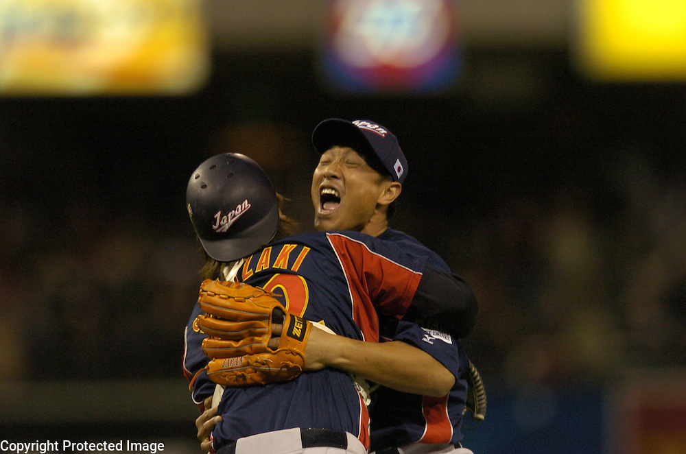 Team Japan's Akinori Otsuka hugs his catcher Tomoya Satozaki after beating Team Cuba 10-6 in Final action of the World Baseball Classic at PETCO Park, San Diego, CA.