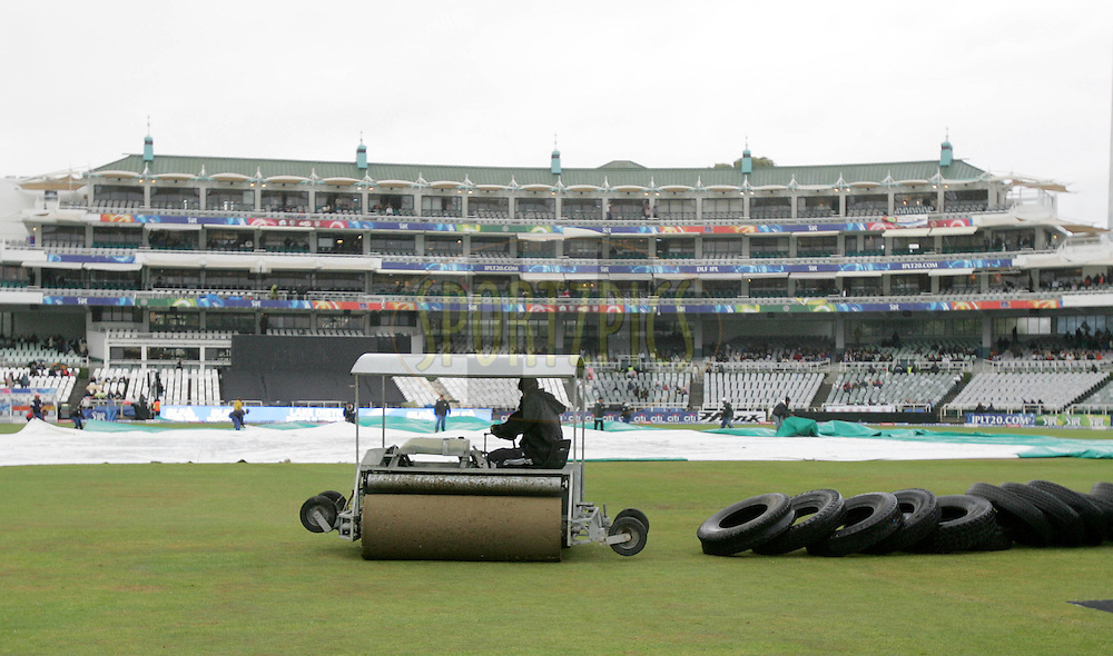 CAPE TOWN, SOUTH AFRICA - 25 April 2009. And the covers come out again during the IPL Season 2 match between The Chennai Superkings  and The Kolkata Knight Riders held at Sahara Park Newlands in Cape Town, South Africa..