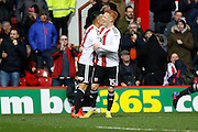 Brentford defender Nico Yennaris (8) and Brentford midfielder Ryan Woods (15) celebrates his goal (score 2-1) during the EFL Sky Bet Championship match between Brentford and Rotherham United at Griffin Park, London, England on 25 February 2017. Photo by Andy Walter.