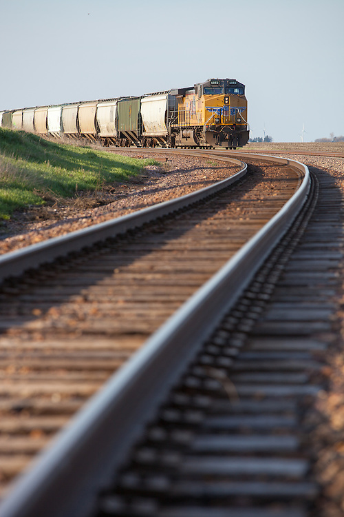 A heavy Union Pacific grain train moves north through the new junction with the BNSF mainline in Edelstein, IL.