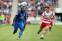 Junior Morias of Peterborough United keeps his eye on the ball along with Tyler Garrett of Doncaster Rovers - Mandatory by-line: Joe Dent/JMP - 02/09/2017 - FOOTBALL - The Keepmoat Stadium - Doncaster, England - Doncaster Rovers v Peterborough United - Sky Bet League One