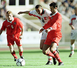 MINSK, BELARUS - Saturday, September 4, 1999: Belarus's Aleksandr Chaika and Wales's Ryan Giggs during the UEFA Euro 2000 Qualifying Group One match at the Dinamo Stadium. (Mandatory credit: David Rawcliffe/Propaganda)