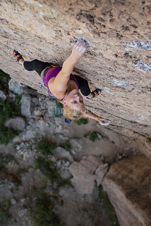"Professional climber Emily Harrington climbing an unnamed 12a route at the ""Wall of Denial,"" in Ten Sleep Canyon Wyoming."